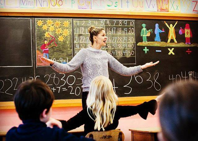 First graders learn with their whole bodies and through their imaginations, in classrooms filled with color.
